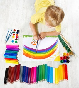 14665926-Child-painting-picture-with-brush-in-album-using-a-lot-of-painting-tools-Top-view-Creativity-concept-Stock-Photo